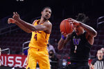 Washington forward Nate Roberts (1) grabs a rebound in front of Southern California forward Evan Mobley (4) during the second half of an NCAA college basketball game Thursday, Jan. 14, 2021, in Los Angeles. (AP Photo/Marcio Jose Sanchez)