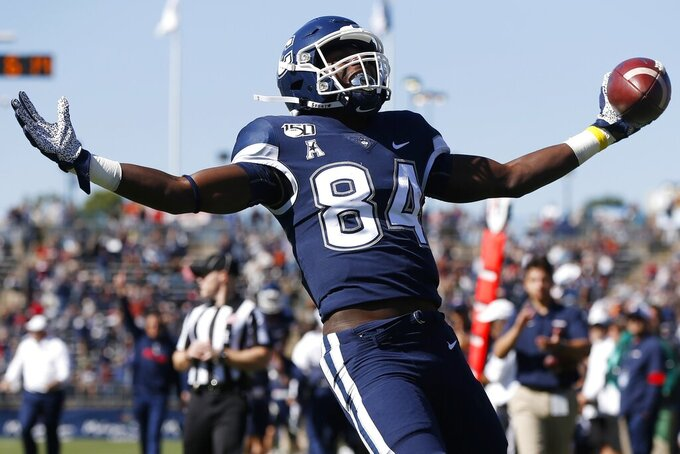 Connecticut wide receiver Elijah Jeffreys celebrates his touchdown during the first half of an NCAA college football game against South Florida in East Hartford, Conn., Saturday, Oct. 5, 2019. (AP Photo/Michael Dwyer)