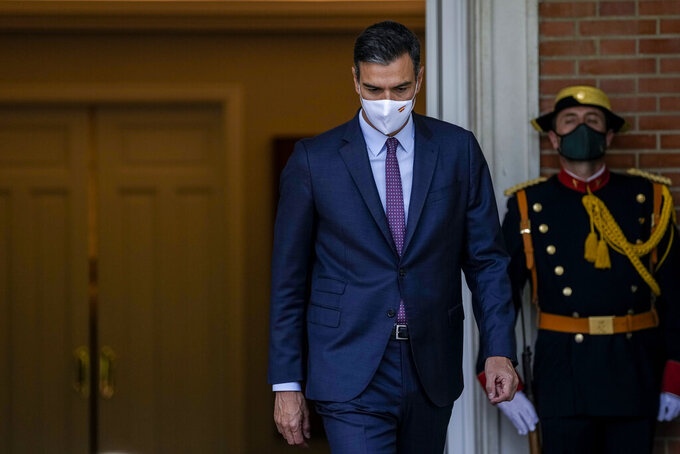 Spanish Prime Minister Pedro Sanchez walks prior to his meeting with Chilean President Sebastian Pinera at the Moncloa palace in Madrid, Spain, Tuesday, Sept. 7, 2021. (AP Photo/Manu Fernandez)