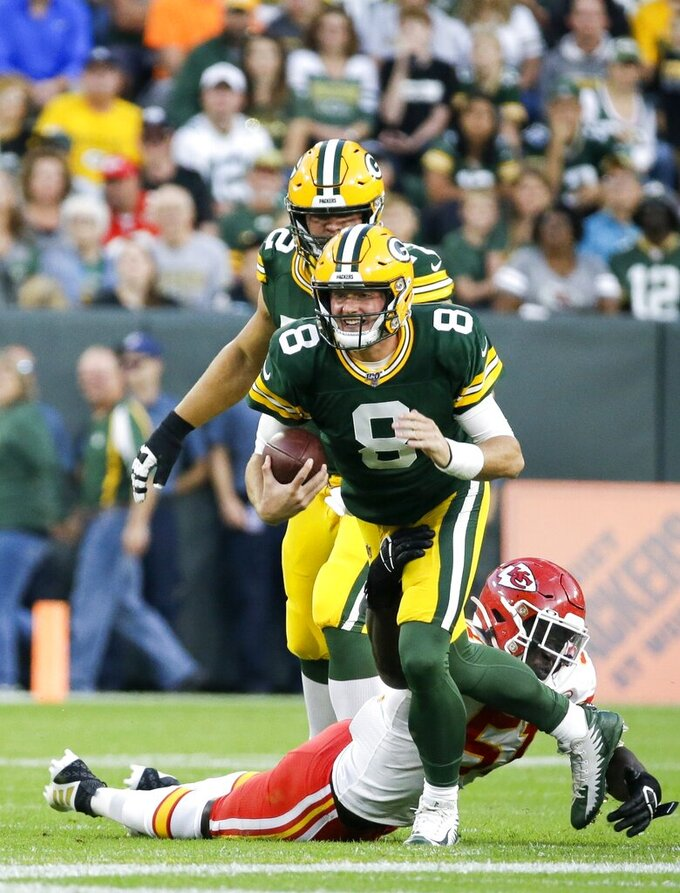 Green Bay Packers' Tim Boyle runs during the first half of a preseason NFL football game against the Kansas City Chiefs Thursday, Aug. 29, 2019, in Green Bay, Wis. (AP Photo/Mike Roemer)
