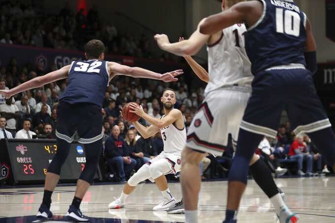 Saint Mary's guard Jordan Ford (3) looks to pass the ball during the first half against Utah State in an NCAA college basketball game in Moraga, Calif., Friday, Nov. 29, 2019. (AP Photo/Jed Jacobsohn)