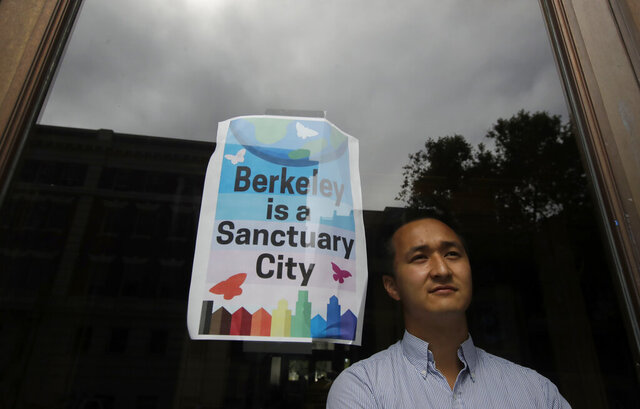 FILE - In this July 18, 2019, file photo, Berkeley councilman Rigel Robinson poses for photos inside the Martin Luther King Jr. Civic Center building in Berkeley, Calif. The politically liberal city of Berkeley in Northern California is considering a proposal to shift traffic enforcement from armed police to unarmed city workers. Backers say they believe the proposal before the Berkeley City Council Tuesday, July 14, 2020, is the first of its kind in the U.S.