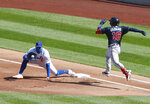 New York Mets first baseman Dominic Smith (2) catches the ball from starting pitcher Rick Porcello to get out Atlanta Braves catcher Travis d'Arnaud (16) during the first inning of a baseball game, Sunday, Sept. 20, 2020, in New York. (AP Photo/Noah K. Murray)