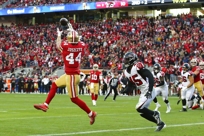 San Francisco 49ers fullback Kyle Juszczyk (44) catches a touchdown pass in front of Atlanta Falcons linebacker Deion Jones (45) during the second half of an NFL football game in Santa Clara, Calif., Sunday, Dec. 15, 2019. (AP Photo/John Hefti)