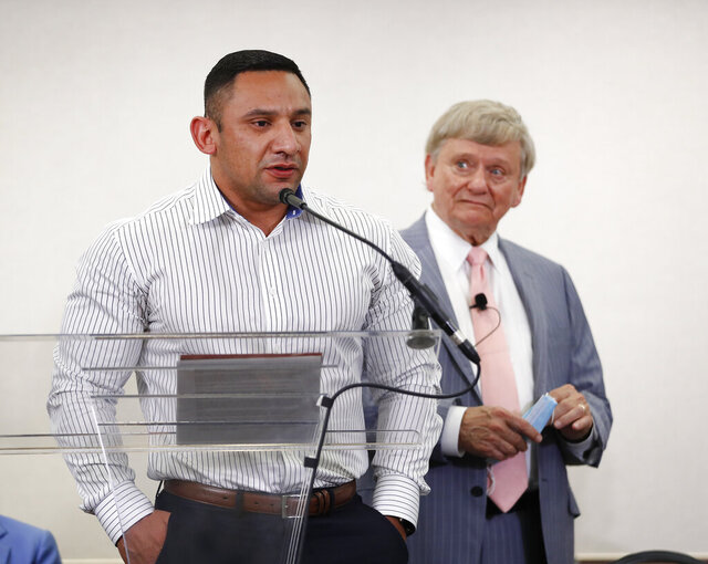 Houston Police officer Felipe Gallegos speaks as lawyer Rusty Hardin listened during a press conference at Hilton Americas, Tuesday, Jan. 26, 2021, in Houston. Gallegos has been charged with murder and is among additional officers who have been indicted as part of an ongoing investigation into a Houston Police Department narcotics unit following a deadly 2019 drug raid, prosecutors announced Monday. (Karen Warren/Houston Chronicle via AP)