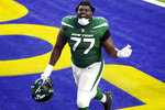 New York Jets offensive tackle Mekhi Becton (77) celebrates as he runs off the field after a win over the Los Angeles Rams during an NFL football game Sunday, Dec. 20, 2020, in Inglewood, Calif. (AP Photo/Ashley Landis)