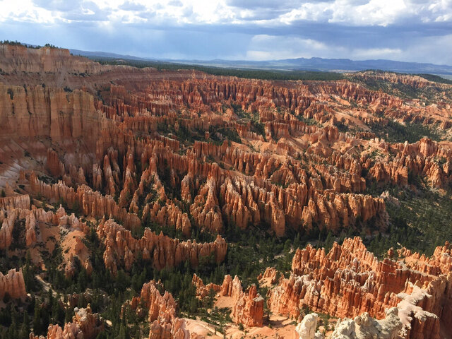 FILE - This May 25, 2017 file photo shows a view of the world-famous hoodoos, also called tent rocks, fairy chimneys and earth pyramids, at Inspiration Point in Bryce Canyon National Park in Utah. The park has become the latest to close its gates to prevent the spread of the coronavirus. The ongoing flow of visitors made it difficult to maintain proper social distancing, park Superintendent Linda Mazzu said in a news release Monday, April 6, 2020. (AP Photo/Eva Parziale, File)