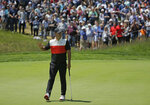 Brooks Koepka reacts after sinking a putt for birdie on the fifth green during the first round of the PGA Championship golf tournament, Thursday, May 16, 2019, at Bethpage Black in Farmingdale, N.Y. (AP Photo/Seth Wenig)