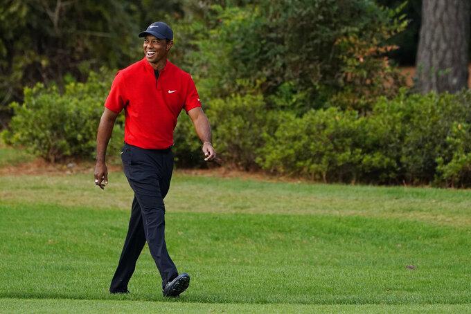 Tiger Woods walks up the 17th fairway during the final round of the Masters golf tournament Sunday, Nov. 15, 2020, in Augusta, Ga. (AP Photo/Matt Slocum)