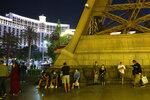 People linger outside Paris Las Vegas following a power outage, which resulted in a building evacuaton, on Thursday, Oct. 22, 2020, in Las Vegas. Caesars Entertainment says the power has been restored at Paris Las Vegas after an outage forced hundreds of guests at the Strip hotel to evacuate. (Ellen Schmidt/Las Vegas Review-Journal via AP)