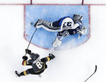 Vegas Golden Knights center Jonathan Marchessault scores past Winnipeg Jets goaltender Connor Hellebuyck during the first period of Game 3 of the NHL hockey playoffs Western Conference finals Wednesday, May 16, 2018, in Las Vegas. (AP Photo/John Locher)