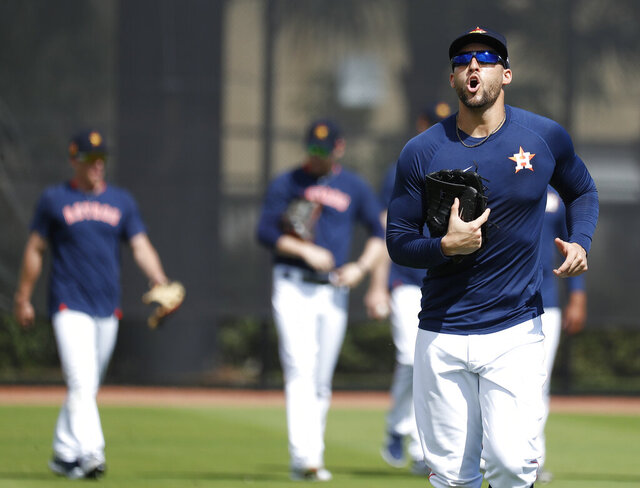 Houston Astros outfielder George Springer yells as he and other outfielders come off the field during baseball spring training Wednesday, Feb. 19, 2020, in West Palm Beach, Fla. (Karen Warren/Houston Chronicle via AP)