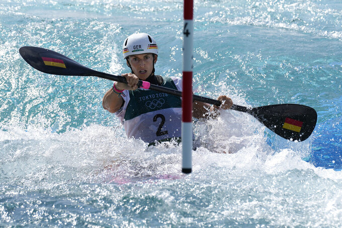 Ricarda Funk of Germany competes in the Women's K1 heats of the Canoe Slalom at the 2020 Summer Olympics, Sunday, July 25, 2021, in Tokyo, Japan. (AP Photo/Kirsty Wigglesworth)