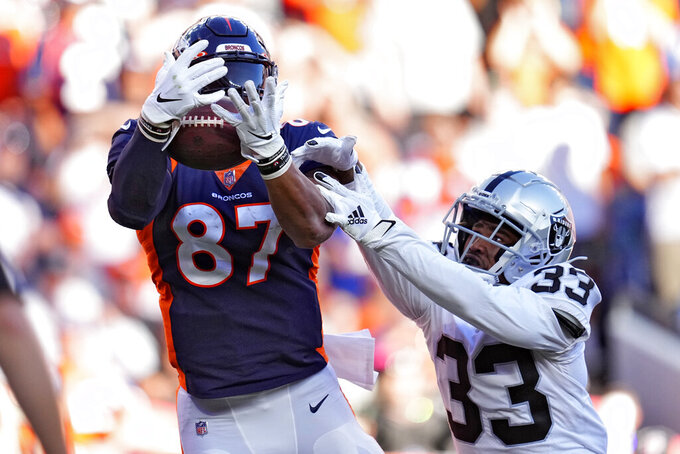 Denver Broncos tight end Noah Fant (87) can't make the catch in the end zone as Las Vegas Raiders safety Roderic Teamer (33) defends during the second half of an NFL football game, Sunday, Oct. 17, 2021, in Denver. (AP Photo/Jack Dempsey)