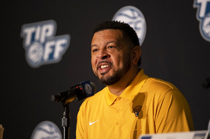 Pittsburgh head coach Jeff Capel smiles during NCAA college basketball Atlantic Coast Conference media day, Tuesday, Oct. 12, 2021, in Charlotte, N.C. (AP Photo/Matt Kelley)