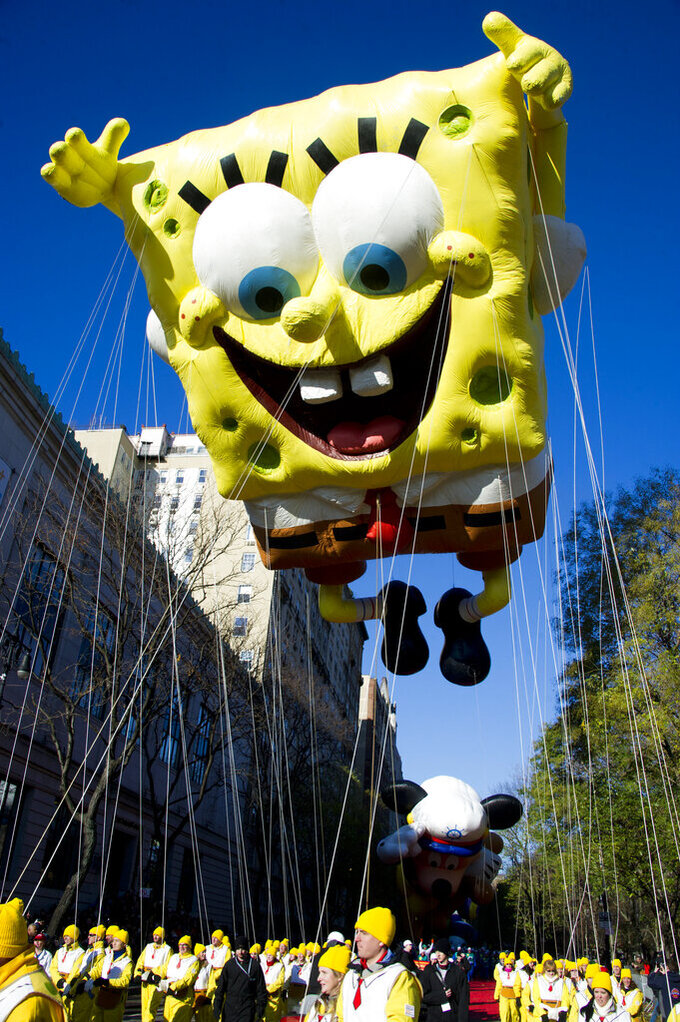 "FILE - In this Nov. 4, 2011, file photo, the SpongeBob SquarePants balloon floats in the Macy's Thanksgiving Day Parade in New York. A sense of humor and a dash of creativity, along with memes from ""The Office,"" ""SpongeBob SquarePants"" and the ""Real Housewives"" franchise, helped NFL teams' social-media crews tell the story of free agency in the age of the coronavirus before deals eventually were allowed to just be announced normally. (AP Photo/Charles Sykes, File)"