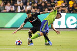 Los Angeles FC forward Brian Rodriguez, left, vies with Seattle Sounders midfielder Cristian Roldan for the ball during the first half of the MLS soccer Western Conference final, Tuesday, Oct. 29, 2019, in Los Angeles. (AP Photo/Ringo H.W. Chiu)