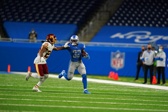 Detroit Lions running back D'Andre Swift (32) running with the ball during an NFL football game against the Washington football team on Sunday, Nov. 15, 2020 in Detroit. The Lions defeated the Washington Football team 30-27. (Detroit Lions via AP).
