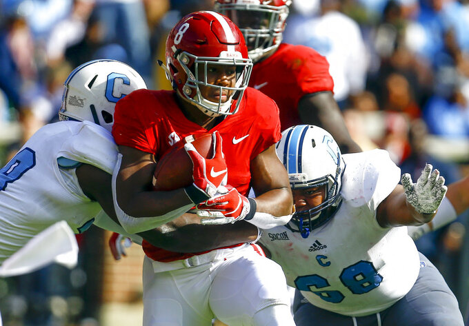 Alabama running back Josh Jacobs (8) carries the ball as he is tackled by Citadel linebacker Noah Dawkins (38) and defensive lineman Ken Allen (68) during the first half of an NCAA college football game, Saturday, Nov. 17, 2018, in Tuscaloosa, Ala. (AP Photo/Butch Dill)