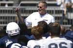 FILE - In this April 14, 2018, file photo, head coach Randy Edsall talks with his team at the end of Connecticut's annual spring NCAA college football game in East Hartford, Conn. UConn will host Central Florida to open the regular season on Thursday, Aug. 30. (AP Photo/Jessica Hill)