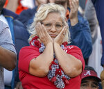 An Alabama fan reacts after an Auburn score during the first half of an NCAA college football game in Auburn, Ala., Saturday, Nov. 30, 2019. (Chris Shimek/The Decatur Daily via AP)