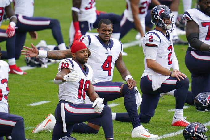 Houston Texans quarterback Deshaun Watson (4) warms up with the team before an NFL football game against the Pittsburgh Steelers, Sunday, Sept. 27, 2020, in Pittsburgh. (AP Photo/Gene J. Puskar)