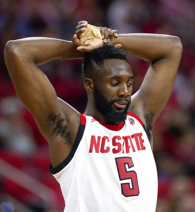 North Carolina State's Eric Lockett (5) rests his hands above his head during the final minutes of an NCAA college basketball game against Virginia Tech in Raleigh, N.C., Saturday, Feb. 2, 2019. (AP Photo/Ben McKeown)