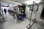 Separated by transparent dividers, customers eat in a restaurant while keeping their distance to help curb the spread of the new coronavirus, in Mexico City, Wednesday, July 1, 2020. (AP Photo/Eduardo Verdugo)