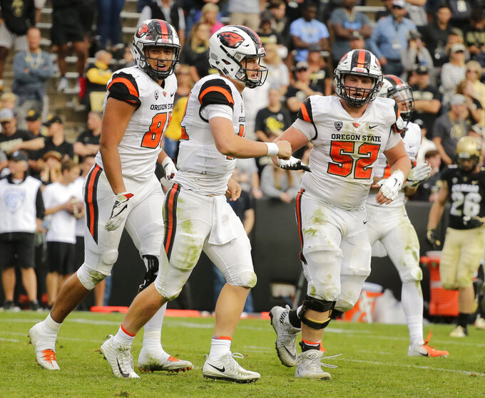 Oregon State quarterback Jack Colletto (12) celebrates an overtime touchdown with teammates during an NCAA college football game against Colorado , Saturday, Oct. 27, 2018, in Boulder, Colo. (AP Photo/Jack Dempsey)