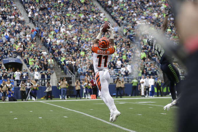 Cincinnati Bengals wide receiver John Ross (11) makes a catch for a touchdown against the Seattle Seahawks during the first half of an NFL football game unday, Sept. 8, 2019, in Seattle.(AP Photo/Stephen Brashear)