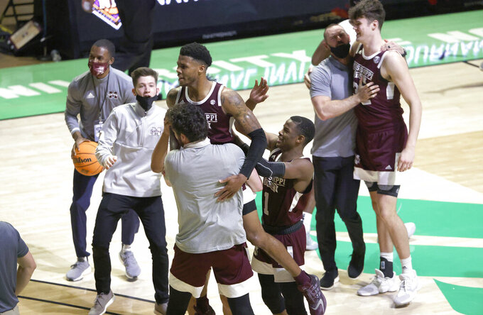 Mississippi State guard D.J. Stewart Jr. (3) is picked up while celebrating with teammates, including guard Iverson Molinar (1) and forward Quinten Post (32), following the team's win over Richmond in an NCAA college basketball game in the semifinals of the NIT, Thursday, March 25, 2021, in Denton, Texas. (AP Photo/Ron Jenkins)