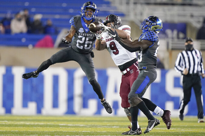 Kentucky defensive back Yusuf Corker (29) and defensive back Brandin Echols (26) break up a pass to South Carolina tight end Nick Muse (9) during the second half of an NCAA college football game Saturday, Dec. 5, 2020, in Lexington, Ky. (AP Photo/Bryan Woolston)