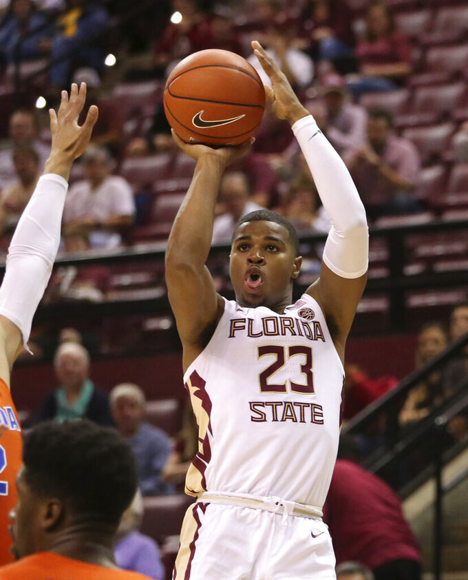 FILE - Florida State's MJ Walker shoots against Florida during the first half of an NCAA college basketball game in Tallahassee, Fla., in this Nov. 6, 2018, file photo. Walker averaged 10.6 points per game last season and made 44 three-pointers, shooting 36.1% from beyond the arc. (AP Photo/Steve Cannon, File)