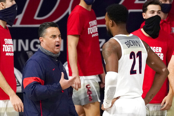 Arizona head coach Sean Miller talks to Jordan Brown (21) during the first half of an NCAA college basketball game against Eastern Washington, Saturday, Dec. 5, 2020, in Tucson, Ariz. (AP Photo/Rick Scuteri)