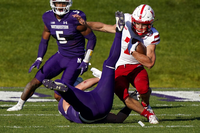Nebraska quarterback Luke McCaffrey, right, is tackled by Northwestern linebacker Blake Gallagher during the second half of an NCAA college football game in Evanston, Ill., Saturday, Nov. 7, 2020. Northwestern won 21-13. (AP Photo/Nam Y. Huh)