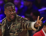 FILE - In this Jan. 29, 2019, file photo, actor Kevin Hart gestures during the second half of an NBA basketball game between the Los Angeles Lakers and the Philadelphia 76ers in Los Angeles. Hart has been injured in a car crash in the hills above Malibu on Sunday, Sept. 1. (AP Photo/Mark J. Terrill, File)