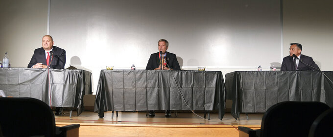 """From left to right,  local talk show radio host Eddy Aragon, incumbent Mayor Tim Keller and Bernalillo County Sheriff Manuel """"Manny"""" Gonzales III take part in the Albuquerque Mayoral Candidate Forum held at Highland High School on Monday, Sept. 27, 2021, in Albuquerque, N.M. The event was hosted by the New Mexico Black Voters Collaborative. (Adolphe Pierre-Louis/The Albuquerque Journal via AP)"""