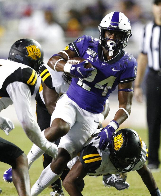 TCU's Darwin Barlow (24) carries against Arkansas-Pine Bluff during an NCAA college football game Saturday, Aug. 31, 2019, in Fort Worth, Texas. (David Kent/Star-Telegram via AP)