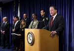 "United States attorney Robert S. Brewer, right, speaks during a news conference Thursday, May 9, 2019, in San Diego. Federal officials announced Thursday that they have filed 109 hate crime charges against the man suspected of opening fire in a Southern California synagogue and said he called a 911 dispatcher afterward to report that he had done it to ""defend my nation"" against the Jewish people. (AP Photo/Gregory Bull)"