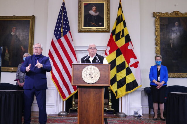 Maryland Gov. Larry Hogan announces the state could begin the first stage of its reopening process, if the rate of hospitalizations from the coronavirus and the number of patients in intensive care continue to level off into next week during a news conference on Wednesday, May 6, 2020 in Annapolis, Md. Hogan also said he is allowing elective surgery and some low-risk activities like golf, tennis, boating and fishing starting on Thursday. (AP Photo/Brian Witte)