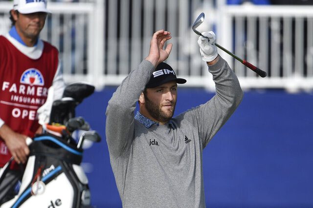 Jon Rahm of Spain reacts after hitting a bunker shot on the 15th hole of the South Course at Torrey Pines Golf Course during the third round of the Farmers Insurance golf tournament Saturday, Jan. 25, 2020, in San Diego. (AP Photo/Denis Poroy)