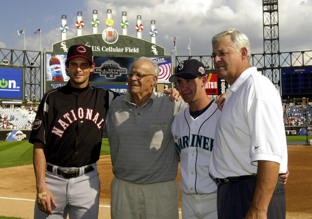 FILE - In this July 15, 2003, file photo, Cincinnati Reds' Aaron Boone, left, and his brother, Bret, from the Seattle Mariners, pose with their grandfather, Ray, and father, Bob, manager of the Cincinnati Reds, right, before the 74th All-Star Game at U.S. Cellular Field in Chicago. (AP Photo/Mark Duncan, File)