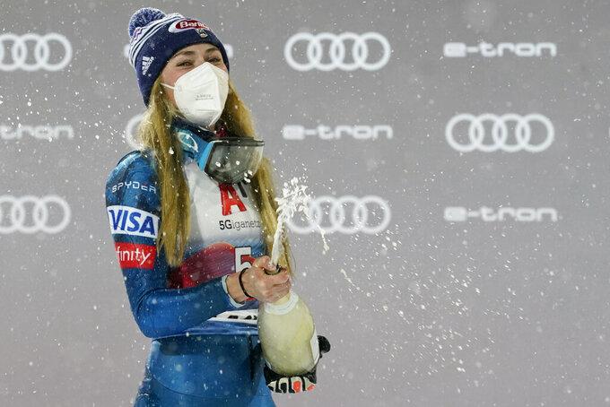 United States' Mikaela Shiffrin celebrates after winning an alpine ski, women's World Cup slalom, in Flachau, Austria, Tuesday, Jan. 12, 2021. (AP Photo/Giovanni Auletta)