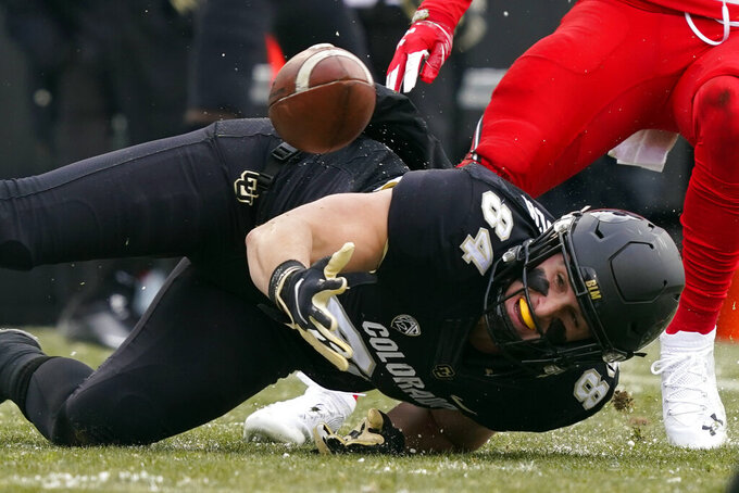 Colorado tight end Matt Lynch misses a pass against Utah in the first half of an NCAA college football game Saturday, Dec. 12, 2020, in Boulder, Colo. (AP Photo/David Zalubowski)