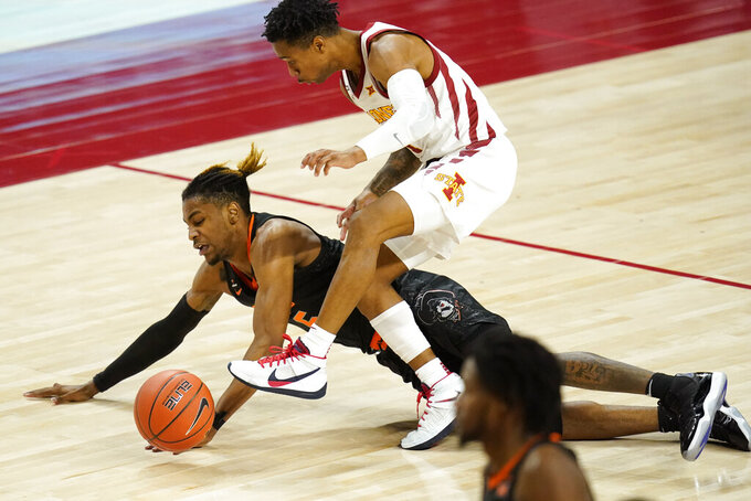 Oklahoma State guard Rondel Walker fights for a loose ball with Iowa State guard Tyler Harris, right, during the second half of an NCAA college basketball game, Monday, Jan. 25, 2021, in Ames, Iowa. Oklahoma State won 81-60. (AP Photo/Charlie Neibergall)
