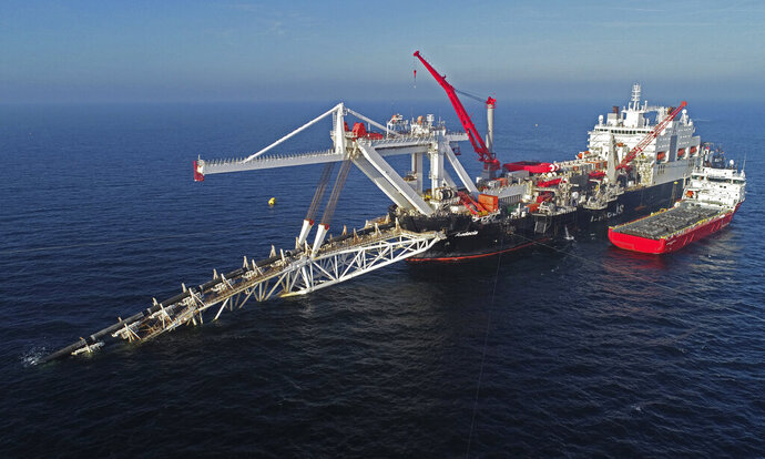FILE - In this Nov. 11, 2018 file photo a ship works offshore in the Baltic Sea on the natural gas pipeline Nord Stream 2 from Russia to Germany. The company building a natural gas pipeline from Russia to Germany says it's confident of getting an outstanding permit from Denmark to close the gap on the 1,200 kilometers ,746 miles, route. (Bernd Wuestneck/dpa via AP)