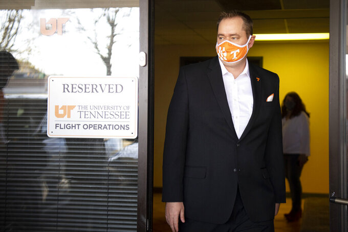 New Tennessee NCAA college football head coach Josh Heupel is shown after arriving in Knoxville, Tenn., Wednesday, Jan. 27, 2021. New Tennessee athletic director Danny White announced Wednesday that he has hired Heupel as Tennessee's 27th head coach overall. (Saul Young/Knoxville News Sentinel via AP)