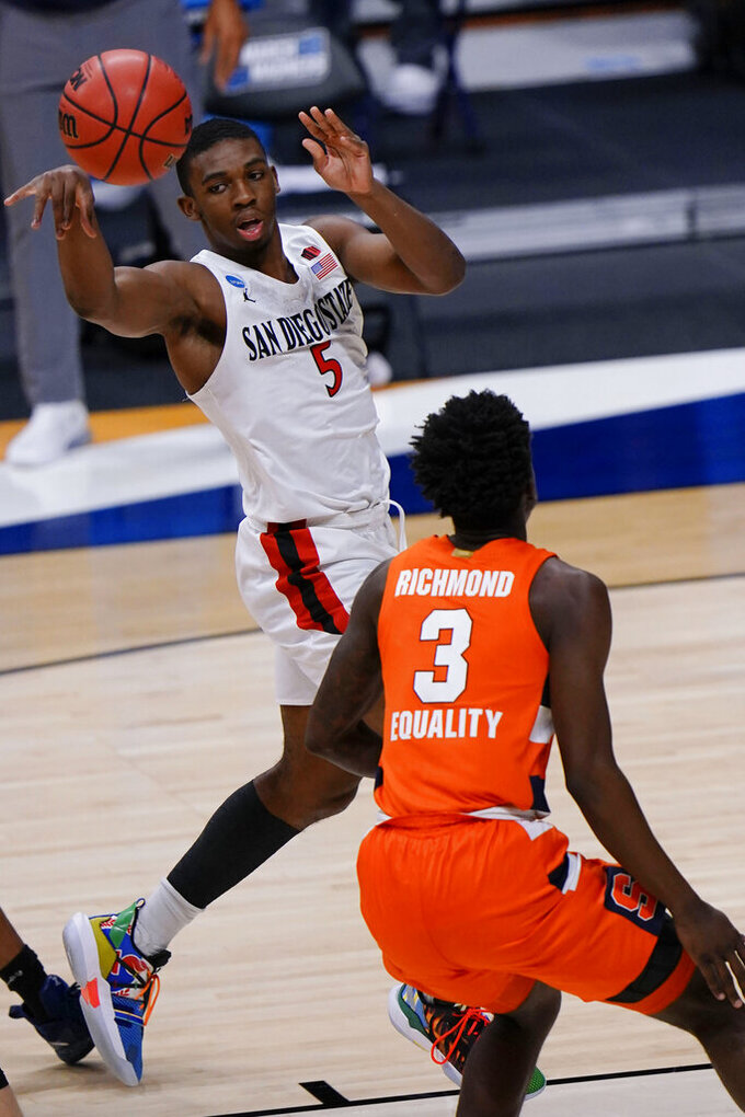 San Diego State guard Lamont Butler (5) passes the ball over Syracuse forward Kadary Richmond (3) during the first half of a college basketball game in the first round of the NCAA tournament at Hinkle Fieldhouse in Indianapolis, Friday, March 19, 2021. (AP Photo/AJ Mast)