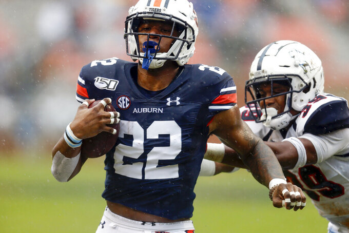 Auburn running back Harold Joiner (22) carries the ball in for a touchdown as Samford linebacker Trimarcus Cheeks (39) defends during the first half of an NCAA college football game, Saturday, Nov. 23, 2019, in Auburn, Ala. (AP Photo/Butch Dill)