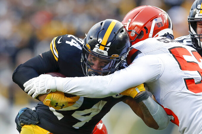 Pittsburgh Steelers running back Benny Snell (24) runs as Cleveland Browns middle linebacker Joe Schobert (53) defends in the second half of an NFL football, Sunday, Dec. 1, 2019, in Pittsburgh. (AP Photo/Don Wright)